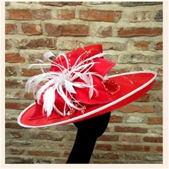 intricately beaded red and white hat with dupion silk petals.