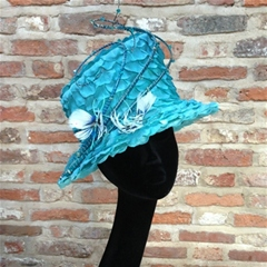 tiny turquoise petals adorn this stylish small brim hat.