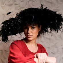 black feather hat with upturned brim