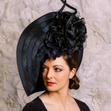 new from guibert millinery. black wave disc with a twist