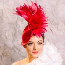 new from guibert millinery. wave headpiece with feathers in fuchsia.