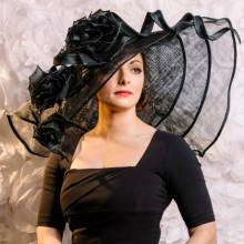 extra special large bold statement hat by guibert. freeform brim with handmade roses.