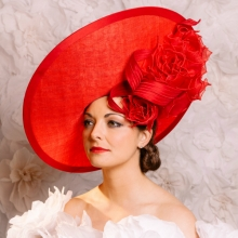 red saucer with organza roses by guibert millinery