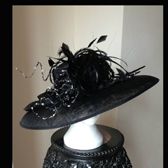 by thomas watts millinery.