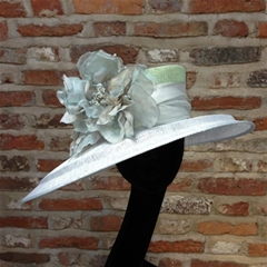Fabulous assymetric brim in subtle tones of pale green and sky blue with organza floral trim.