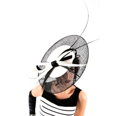 striking black and white tilted disc, edged with window sinamay and trimmed with full length black quills for added drama! set on a headband. available to hire.