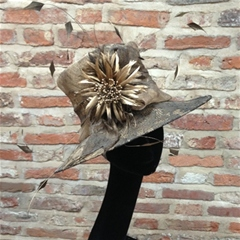 lustrous bronze hat with lace effect brim.