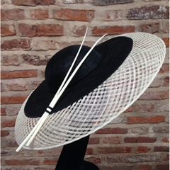 Classic ivory & black downbrim hat. Classic, elegant style, the basket woven outer brim diffuses light onto the face with flattering effect.