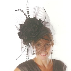 black disc of pleated crin with rose detail, set on alice band. also available in other colours.