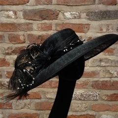 classic downbrim with curled ostrich feathers and intricate beadwork.