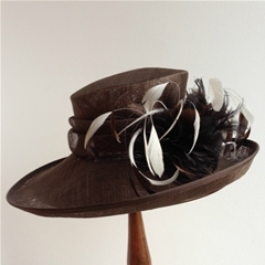 my hat side swept brim with folded sinamay trimming and ivory coque feathers.