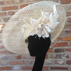 classic cream guibert tilted sinamay disc with velour headpiece, sculptured twists and rose below the brim. so elegant.