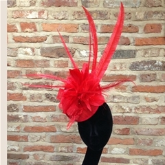 glorious bold red fascinator which stays in place with millinery elastic. comfortable, beautiful and easy to wear all day!