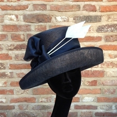 Herald & Heart navy upturn brimmed hat with arrowhead feather and organza bow.