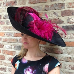 glorious extra large upturned brimmed hat dressed with fuschia pink feathers. by the famous rye milliners herald & heart. if you like a hat with a dramatic upswept brim - this is a strong contender!