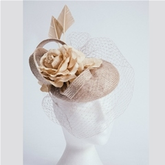 Almond parasisal beret with silk rose, arrowhead feathers and veiling. Handmade by our own milliners, using traditional techniques. Demure and sophisticated. Can be made to order in your own colours.