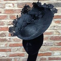 delicately decadent black headpiece which features finest french corded lacework. fastens on a millinery elastic and comb. simply stunning.