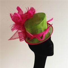 lime top hat with fuschia hackle mount and sinamay swirls. secures with millinery elastic.