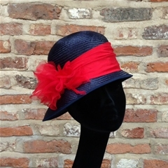 Navy blue straw cloche, red dupion silk trim and rose detail. Versatile hat, can be made in any colours for horse show dudges and show pony leaders.