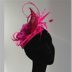 by vivien sheriff. mind the gap in fuschia pink. set on a headband.