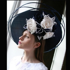 classic navy blue guibert tilted disc with intricately woven outer brim, trimmed with ivory hand crafted silk roses. beautiful.