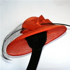 bright orange down brim by nigel rayment with silk bow and ostrich feather.