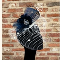 vivien sheriff navy basket weave loop with curled spadonas and veiling. fastens on a comb.