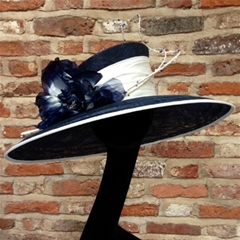 classic navy and white downbrim hat with dupion silk trim and beadwork.