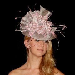 silver sinamay guibert pleated fanfare featuring lustrous silver petals edged with pastel pinks.