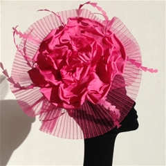 dramatic circle of pleated crinoline with fuschia flower and feather detail. set on a wide padded headband. available in other colours too.