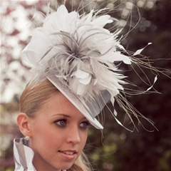 White top hat base layered with silk sash and flower detail.