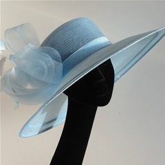 a summery shade of pale blue delivers the feel-good factor with this stunning whiteley hat.