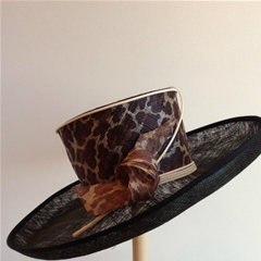 by philip somerville. black hat with leopard print detail.