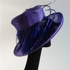 by vivien sheriff millinery. in a glorious shade of purple with beadwork and feather trim.