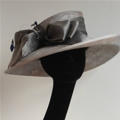 by vivien sheriff millinery. silver east-west brim with organza bow.