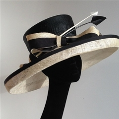 whiteley hat in ivory and black with arrowhead feathers.