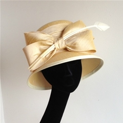 decadent silk hat finished with bow detail.