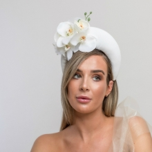 white crown with floral detail