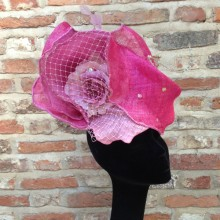 a one-off pretty pink sculptured sinamay headpiece.