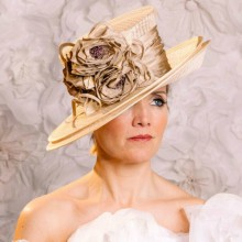 beautiful double brim ivory hat with rose detail.