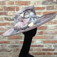 classic east-west brim in lilac sinamay trimmed with silk and feather detail.