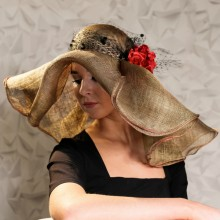 huge freeform gold hat with roses