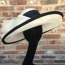 elegant wide east-west brim with black sash. also available to hire.