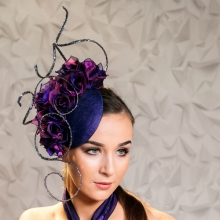 headpiece by guibert with purple roses