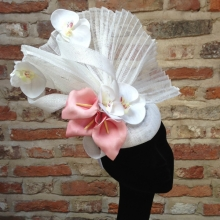 white beret headpiece with lilies and orchids