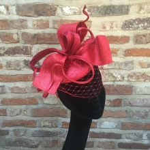 red straw pillbox with veiling