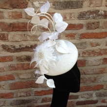white straw beret with silk woven leaves